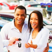 couple picking up used car from Philly Auto used cars