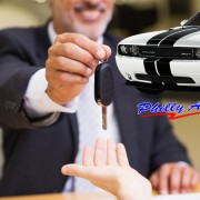 Philly Auto salesman giving a customer car keys