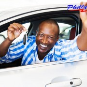 happy man showing a car key