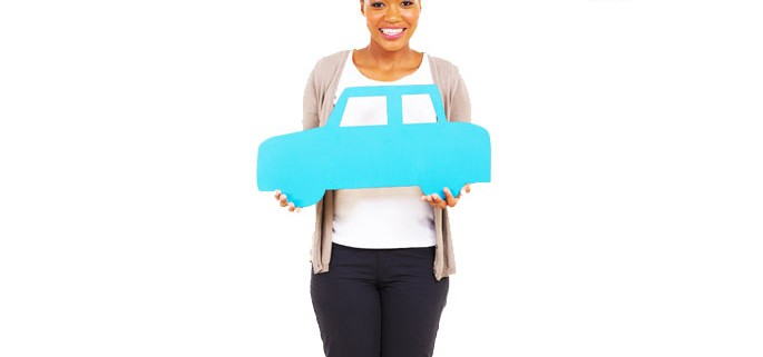american woman holding paper car